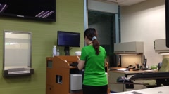 td bank teller withdrawing money for customer - stock footage