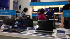 People buying new computer inside inside best buy store Stock Footage