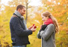 Smiling couple with engagement ring in gift box Stock Photos