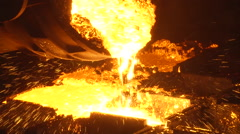 Iron and Steel Works. Pouring of molten iron. HDV to HD - stock footage