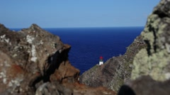 Small lighthouse on a rock  blue ocean Stock Footage