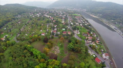 Small village town aerial shot, misty fog, river mountains air, click for HD Stock Footage