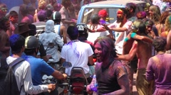Motorcycle and car go people celebrating Festival of colors Holi Stock Footage
