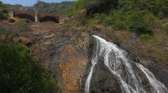 Mangali waterfall with train bridge Stock Footage