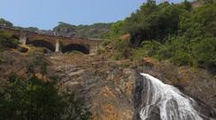 Train on bridge above Mangali waterfall Stock Footage