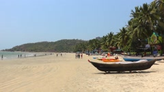 Palolem beach with small boat Stock Footage