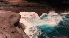 Blue wave washed rocks Stock Footage