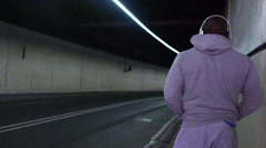 View from behind of athletic figure in urban environment Stock Footage