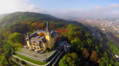 Beautiful city town castle, yellow building aerial fly around, click for HD Stock Footage