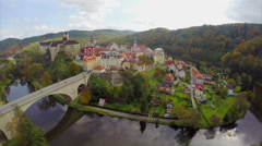 Spectacular medieval castle colorful buildings aerial shot, moat, click for HD Stock Footage