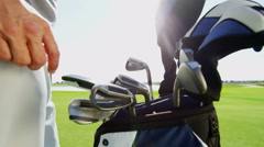 Stock Video Footage of Male Caucasian Professional Golfer Sport Game Lifestyle Golf Bag Clubs