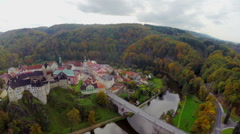 Czech castle aerial shot, moat buildings color, autumn fall fort, click for HD Stock Footage