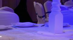 Interior designer decorates banquet table Stock Footage