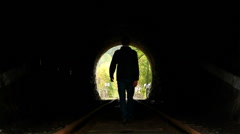 Stock Video Footage of Man walking to light end of tunnel, search of hope, click for HD