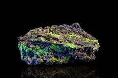 malachite and azurite mineral stone with black background - stock photo