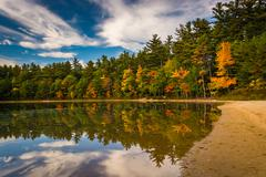 early fall color and reflections at echo lake in echo lake state park, new ha - stock photo