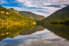 early fall reflections at  echo lake, in franconia notch state park, new hamp - stock photo