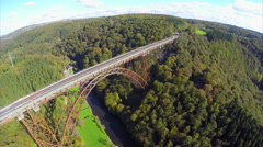 Old bridge constriction over valley river aerial shot Mungstener, click for HD Stock Footage