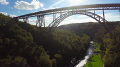 High huge bridge silhouette in sunlight aerial shot, railroad, click for HD Stock Footage