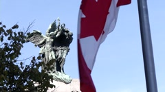 Canadian Flag Flying at Half Mast at War memorial in Ottawa Ontario Canada - stock footage
