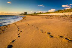 footprints in the sand at coral cove park, jupiter island, florida. - stock photo