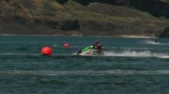 Female jet ski racer Stock Footage