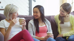 Young people socialising together and having fun over a coffee Stock Footage