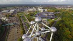 Symbol of Belgium, Atomium Belgian flag waving above, aerial, click for HD Stock Footage