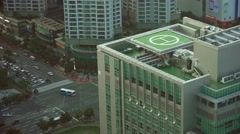 Helicopter Landing Pad On Top Of Building Next To Busy Street Traffic 4K Stock Footage