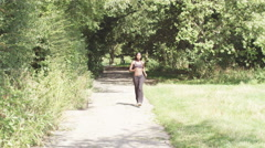 Young, sporty woman with personal trainer and stopwatch. slow motion - stock footage