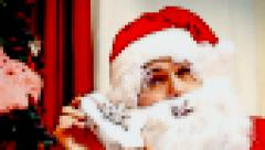 Christmas Eve Santa Claus showing gifts pixelated Stock Footage