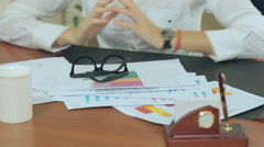 Close-up of girl considering the documents and graphics - stock footage