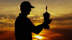 Stock Video Footage of Professional Male Caucasian Winner Golf Sunset Commercial Sponsorship Wealth