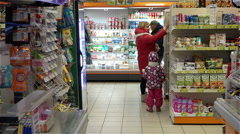 People choose foods on the shelves in the store Stock Footage