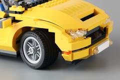 "lego creator set ""3-in-1 cool cruiser"" with focus on wheel. - stock photo"