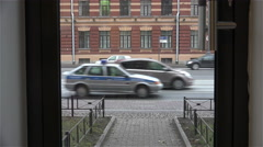 vehicular traffic behind a glass door office - stock footage