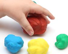 child's hand with playdough - stock photo