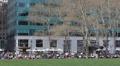 Bryant Park Midtown Manhattan New York City People Crowd Relaxing Lunch Break US Footage