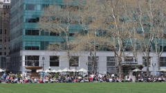 Bryant Park Midtown Manhattan New York City People Crowd Relaxing Lunch Break US Stock Footage