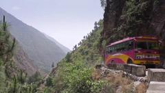 Bus going through mountain pass in India Stock Footage