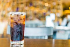 cola glass on bokeh background - stock photo