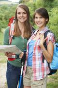 Two young women hiking in countryside together Kuvituskuvat
