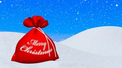 Red bag with Merry Christmas sign under snowfall - stock footage