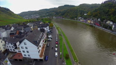 Quay of small village colorful houses, river ships, parked cars, click for HD Stock Footage