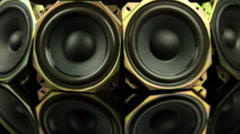 Tracking dolly shot of group of loudspeakers staying on black background 3 Stock Footage