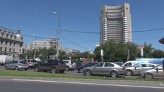 Many cars stopped at red color traffic light, downtown crowded traffic commuters Stock Footage