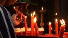 Prayer and candles in Vietnam with man lighting Stock Footage