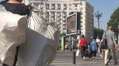 People cross the street, pedestrian crossing used, crowded place in big town Stock Footage