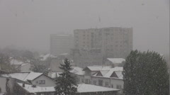 First year snow in beautiful town, houses and tall flat covered by white flakes Stock Footage