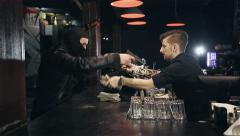 Successful bar robbery. The robber breaks into a bar and takes the money - stock footage